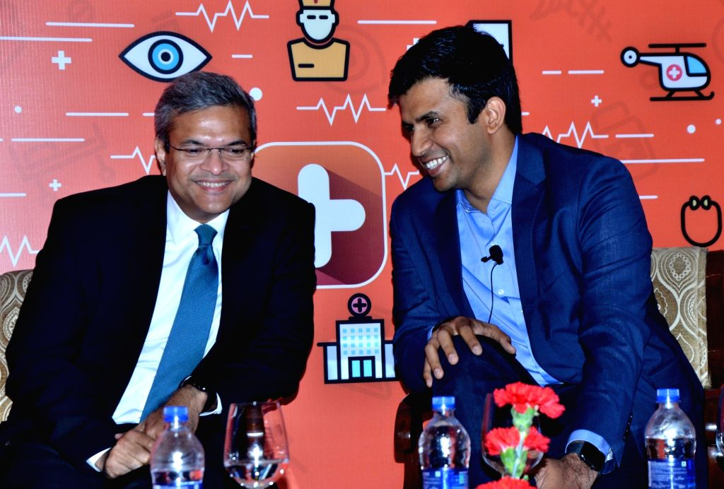 Practo founder and CEO Shashank N.D with ICICI Lombard General Insurance MD and CEO Bhargav Dasgupta addresses a press conference regarding the launch of a health insurance app in New ...