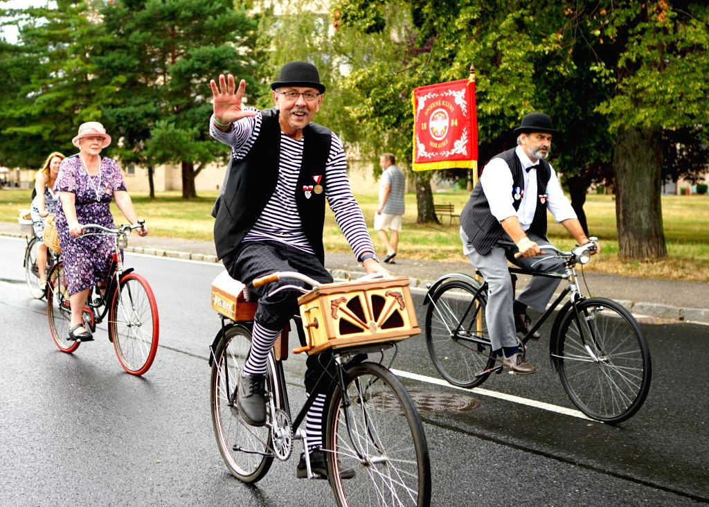 PRAGUE, Aug. 10, 2019 - Cyclists take part in a commemorative ride in Kutna Hora, the Czech Republic, Aug. 10, 2019. Dozens of cyclists in traditional clothing rode historical bikes and passed ...