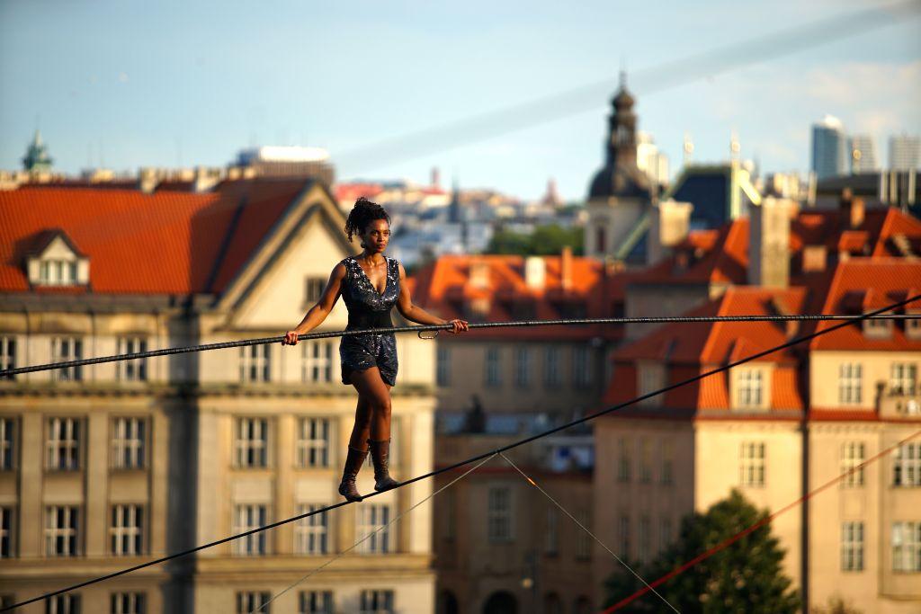 PRAGUE, Aug. 14, 2019 - French rope walker Tatiana-Mosio Bongonga walks on a rope in Prague, the Czech Republic, on Aug. 14, 2019. Tatiana-Mosio Bongonga from the French troup Cie Basinga Wednesday ...
