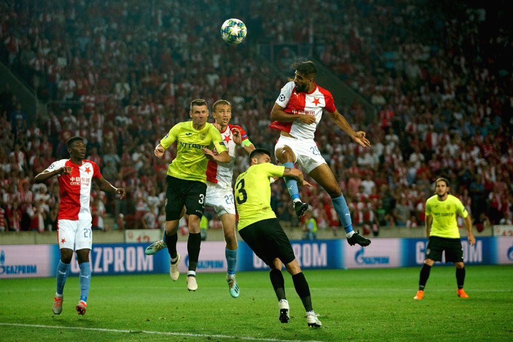 PRAGUE, Aug. 29, 2019 - Slavia Prague's Abdulla Yusuf Helal (2nd R) heads the ball during the 2nd leg match between Slavia Prague and Romanian Cluj at the UEFA Champions League play-offs, in Prague, ...