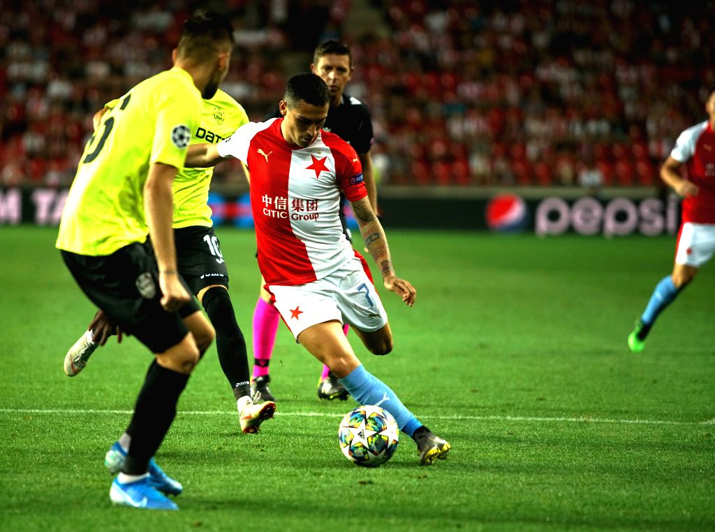PRAGUE, Aug. 29, 2019 - Slavia Prague's Nicolae Stanciu (R) competes during the 2nd leg match between Slavia Prague and Romanian Cluj at the UEFA Champions League play-offs, in Prague, the Czech ...