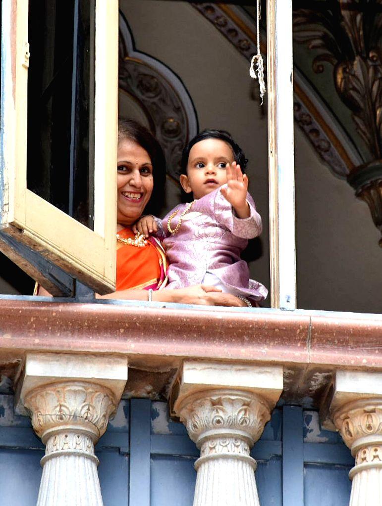 Pramoda Devi Wadiyar, the head of the erstwhile royal family with Aadyaveer Narasimharaja Wadiyar, son of Yaduveer Krishnadatta Chamaraja Wadiyar and Trishika Devi during Ayudha Pooja at ...