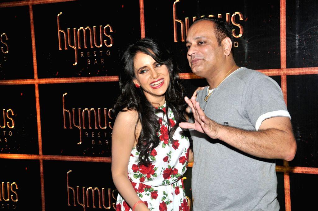 Prashant Virendra Sharma with Shweta Khanduri during the party organised to celebrate the opening of Hymus Resto Bar in Mumbai, on August 12, 2016. - Prashant Virendra Sharma