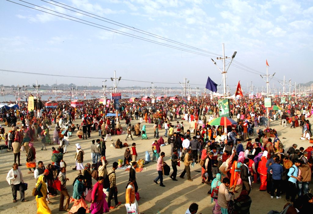 "Prayagraj: Pilgrims in large numbers arrive at Sangam to take a holy dip at the trinity of rivers Ganga, Yamuna and the mythical Saraswati, on the occasion of ""Maghi Purnima"" during Kumbh Mela, in Prayagraj, on Feb 19, 2019. (Photo: IANS)"