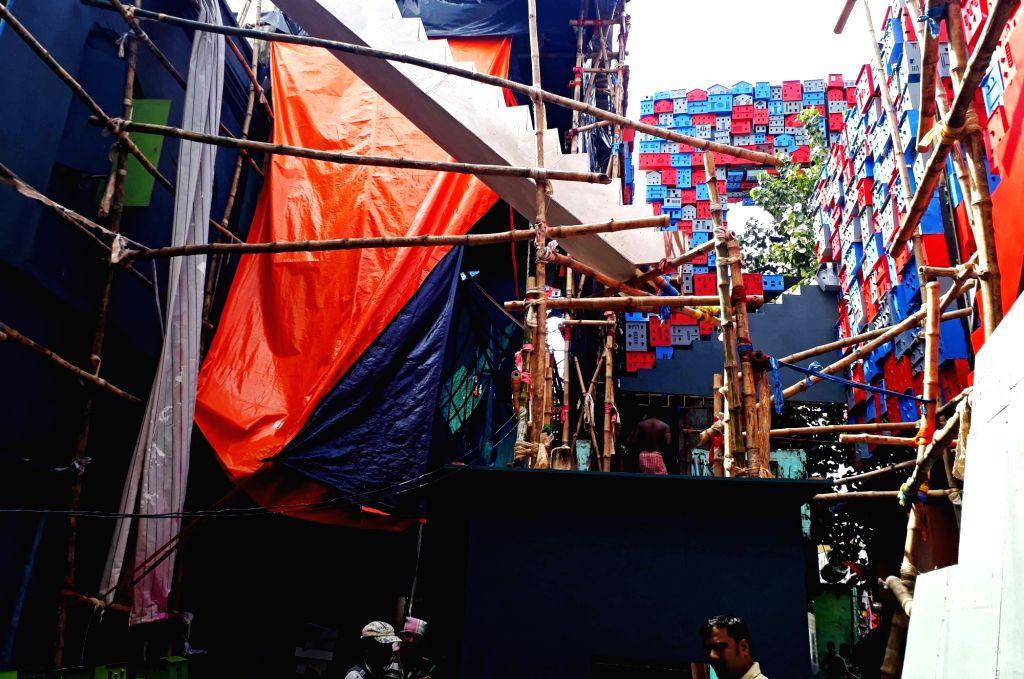 Preparation of Community Puja pandal underway ahead of Durga Puja, in Kolkata on Sep 22, 2019.