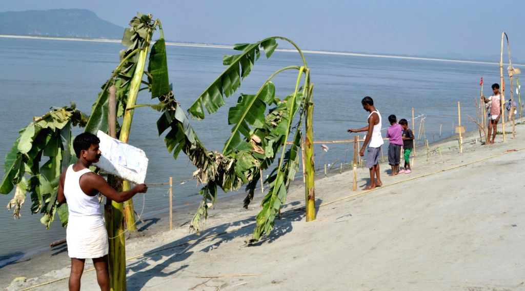 Preparations for Chhath Puja underway on the banks of river Brahmaputra in Guwahati on Nov. 13, 2015.