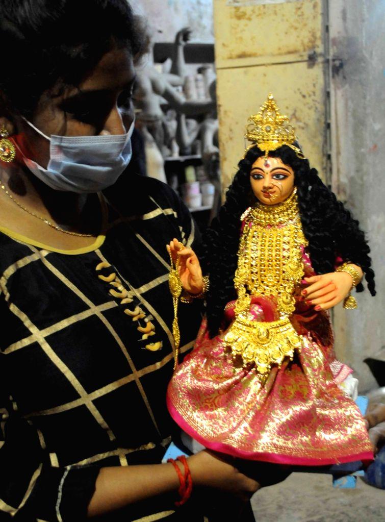 Preparations for Laxmi Puja celebrations underway at Kumartuli workshop, in Kolkata on Oct 28, 2020.