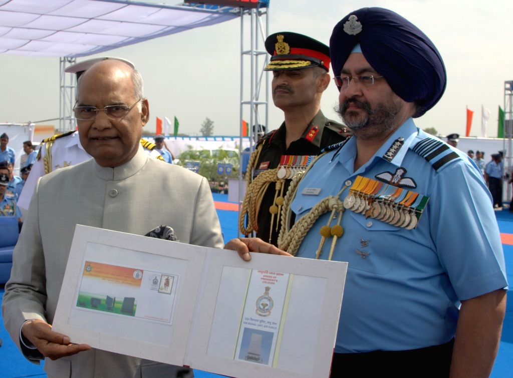 President and Supreme Commander of the Indian Armed Forces Ram Nath Kovind releases the First Day Covers of 230 Signal Unit, at Air Force Station in Halwara, Punjab on March 22, 2018. Also ...