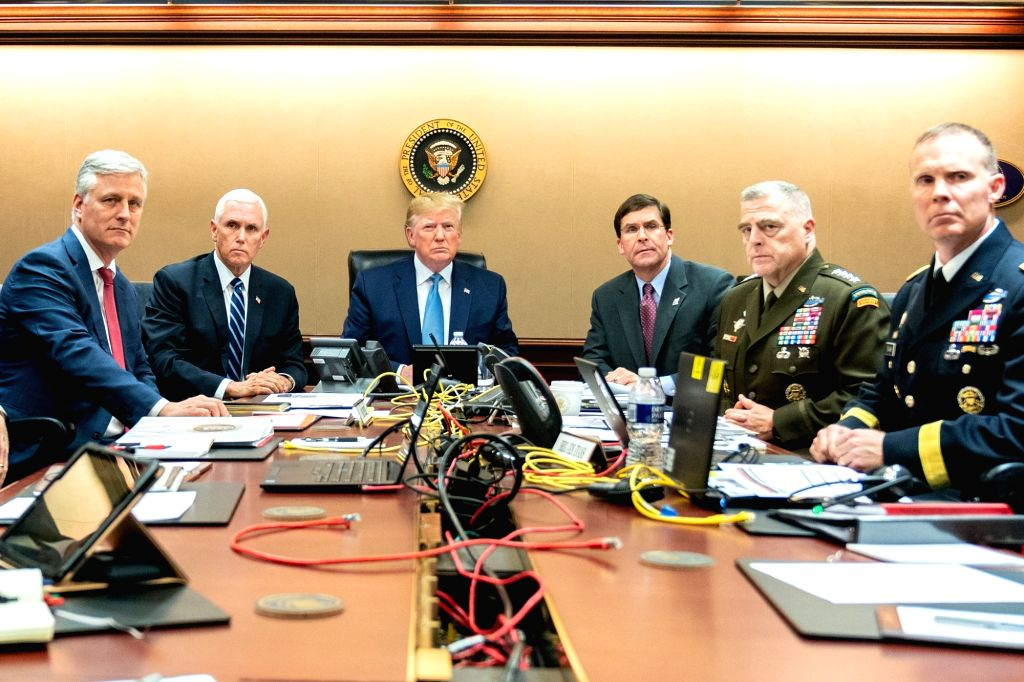 President Donald Trump is joined by Vice President Mike Pence, National Security Advisor Robert O'Brien, left; Secretary of Defense Mark Esper and Chairman of the Joint Chiefs of Staff U.S. Army General Mark A. Milley, and Brig. Gen. Marcus Evans,