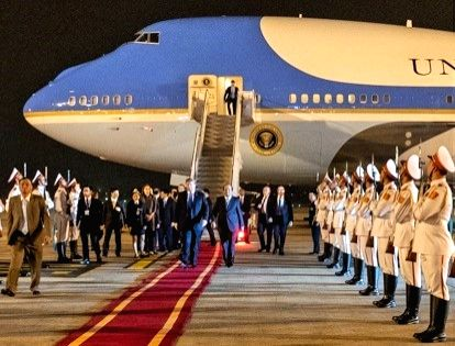President Donald Trump walks along a red carpet from Air Force One and reviews a guard of honour on his arrival on Tuesday, Feb. 26, 2019, at Noi Bai International Airport in Hanoi. (Photo: White House/IANS)