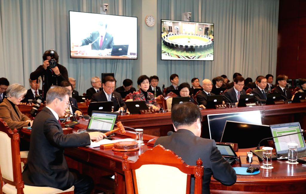 President Moon Jae-in (2nd from L) presides over a Cabinet meeting at the presidential office Cheong Wa Dae in Seoul on Feb. 13, 2018. It was the first such meeting for Moon, who took office ...