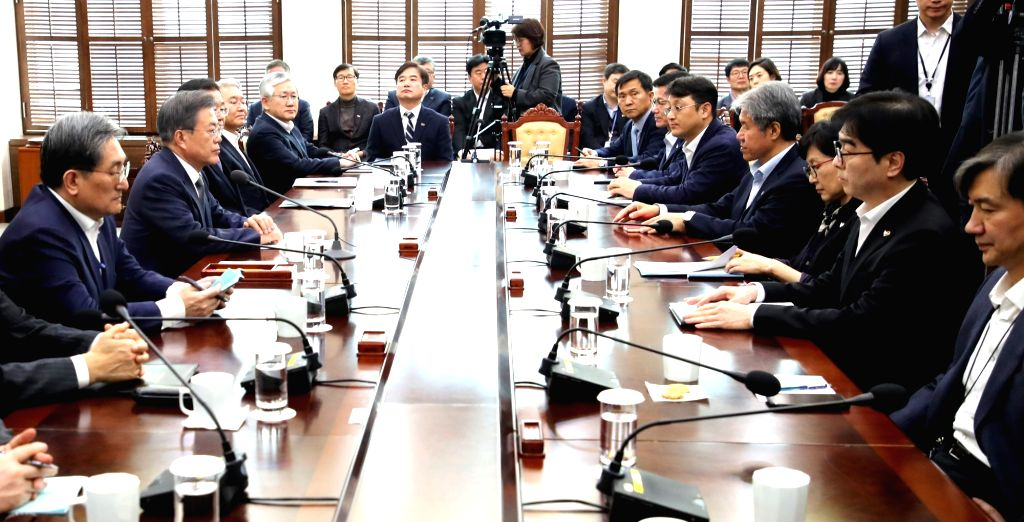 President Moon Jae-in (2nd from L) speaks during a meeting with his senior secretaries at the presidential office in Seoul on Feb. 18, 2019.