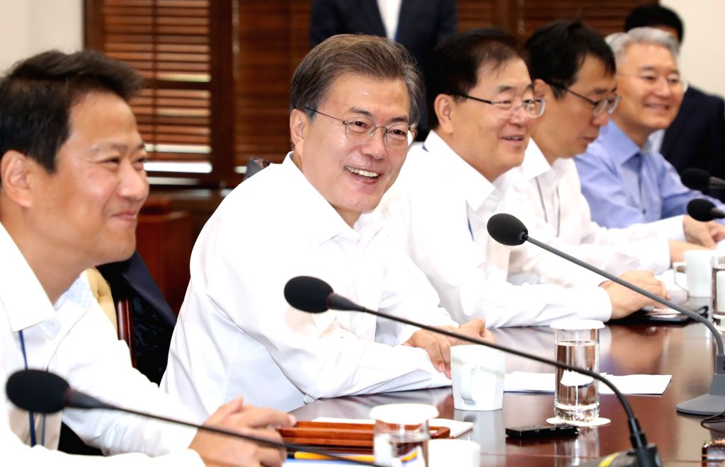 President Moon Jae-in (2nd from L) speaks in a meeting with his senior secretaries at the presidential office Cheong Wa Dae in Seoul on Oct. 10, 2017.