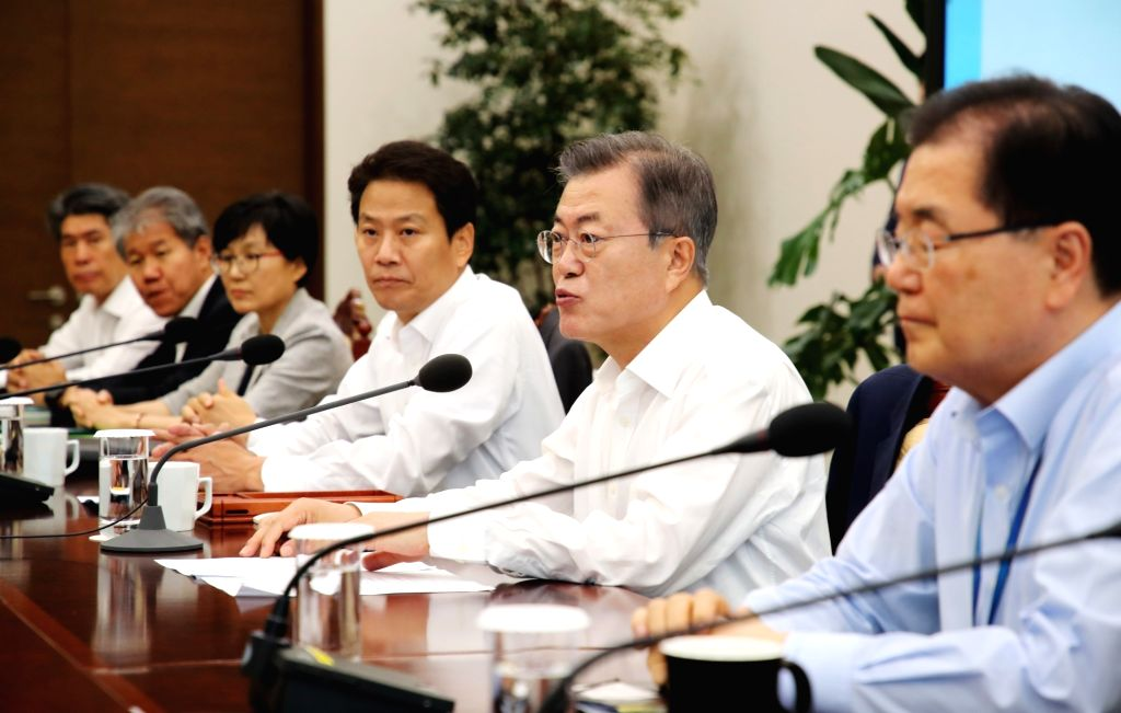 President Moon Jae-in (2nd from R) chairs a Cabinet meeting at his office Cheong Wa Dae in Seoul on Sept. 17, 2018. Moon will travel to Pyongyang from Sept. 18-20 with aides, business leaders, ...