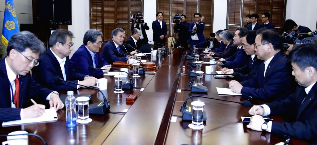 President Moon Jae-in (4th from L) chairs a meeting of the National Security Council at his office Cheong Wa Dae in Seoul on March 4, 2019. The meeting was convened to discuss the aftermath of ...