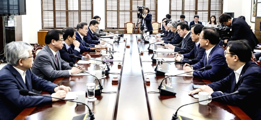 President Moon Jae-in (4th from L) presides over a National Security Council (NSC) meeting at Cheong Wa Dae in Seoul on June 14, 2018, in this photo provided by the presidential office.
