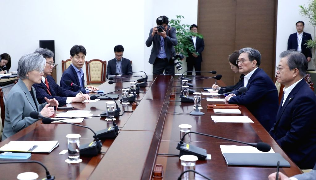 President Moon Jae-in (far R) is briefed by Foreign Minister Kang Kyung-wha (far L) at the presidential office Cheong Wa Dae in Seoul on June 3, 2019, on the deadly sinking of a tourist boat ... - Kang Kyung