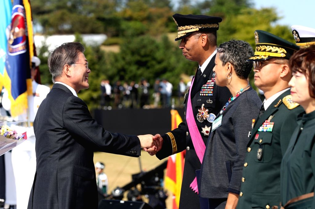 President Moon Jae-in (L) shakes hands with Gen. Vincent Brooks, commander of U.S. Forces Korea, after conferring the Tongil Medal of the Order, the highest national security merit, on Brooks ...