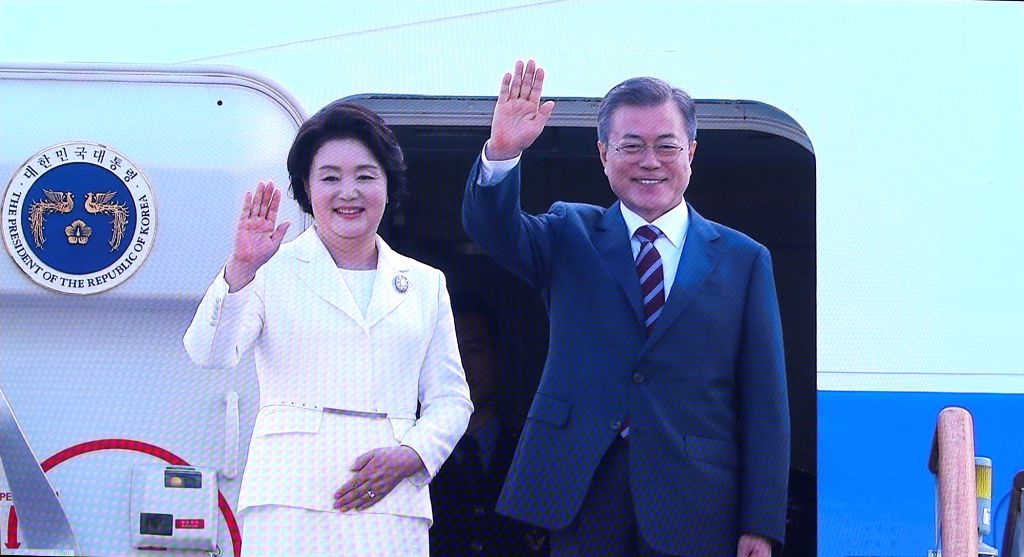 President Moon Jae-in (R) and first lady Kim Jung-sook wave to the send-off team before boarding a plane to Pyongyang on Sept. 18, 2018, from Seoul Air Base in Seongnam, south of Seoul. Moon ...