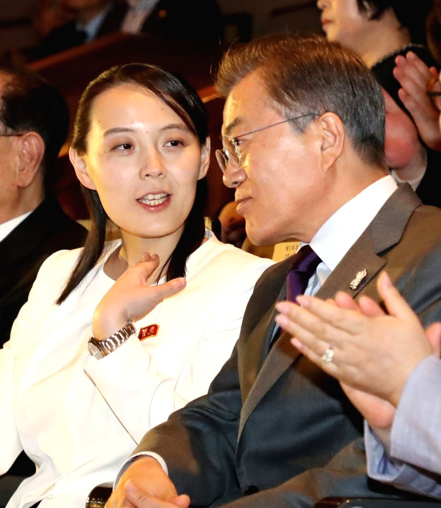 President Moon Jae-in (R) listens to the sister of North Korean leader Kim Jong-un, Kim Yo-jong, as they jointly attend a concert, staged by the North's Samjiyon Orchestra, at the National ...