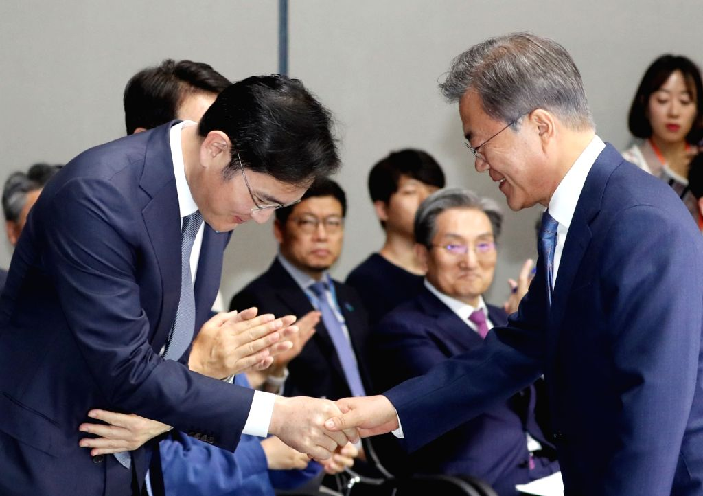 President Moon Jae-in (R) shakes hands with Samsung Electronics Co's (SEC) Vice Chairman Lee Jay-yong during a ceremony to declare a vision for South Korea's semiconductor industry at an SEC plant in ...