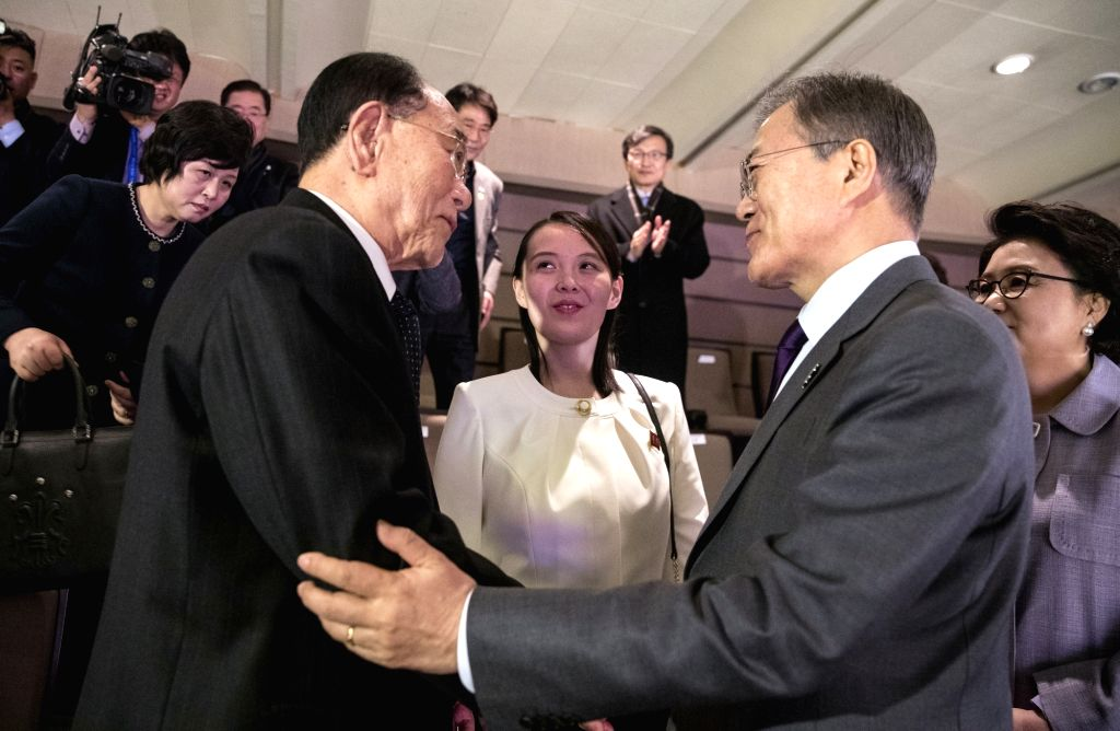 President Moon Jae-in (R) talks with the sister of North Korean leader Kim Jong-un, Kim Yo-jong (C), and Kim Yong-nam, president of North Korea's Presidium of the Supreme People's Assembly, ...