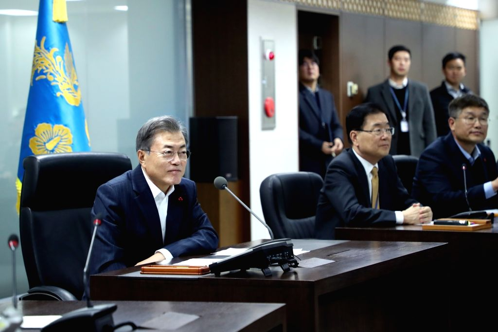 President Moon Jae-in receives a report on the progress of the two Koreas verifying the withdrawal of guard posts inside the Demilitarized Zone during the defense ministry's business report at ...