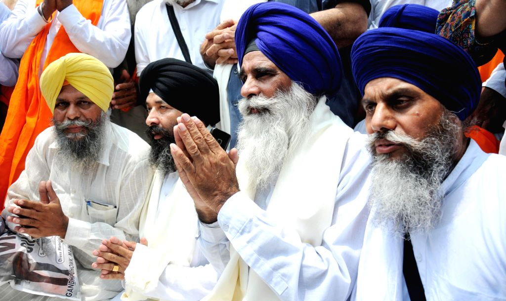 President of Haryana Sikh Gurudwara Management Committee Jagdish Singh Jhinda and others arrive to pay obeisance at the Golden Temple in Amritsar on July 28, 2014.