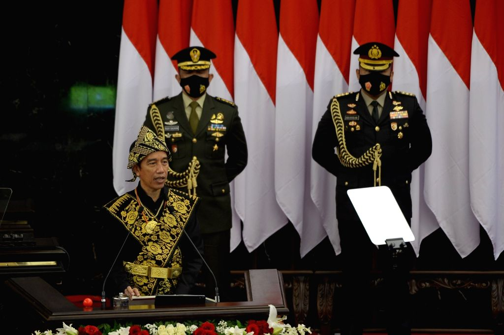 President of Indonesia Joko Widodo (L, front) delivers his annual speech in front of members of the parliament at the parliament building in Jakarta, Indonesia, ...