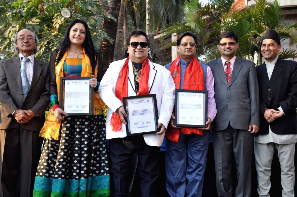 President of National Federation of UNESCO Clubs Centres & Association of Nepal Hari Banshi Kirati, fashion designer Agnimitra Paul and music director Bappi Lahiri during an event organised to ...