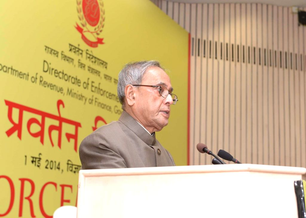 President Pranab Mukherjee addresses during a programme organised on  'Enforcement Day' to celebrate Foundation Day of the Enforcement Directorate at Vigyan Bhavan in New Delhi on May 1, 2014. - Pranab Mukherjee