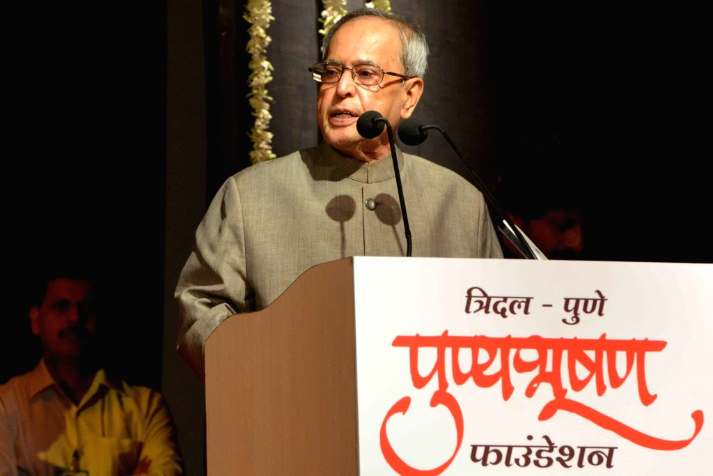 President Pranab Mukherjee addresses during the presentation of the Punyabhushan Awards, in Pune, Maharashtra on June 26, 2015. - Pranab Mukherjee