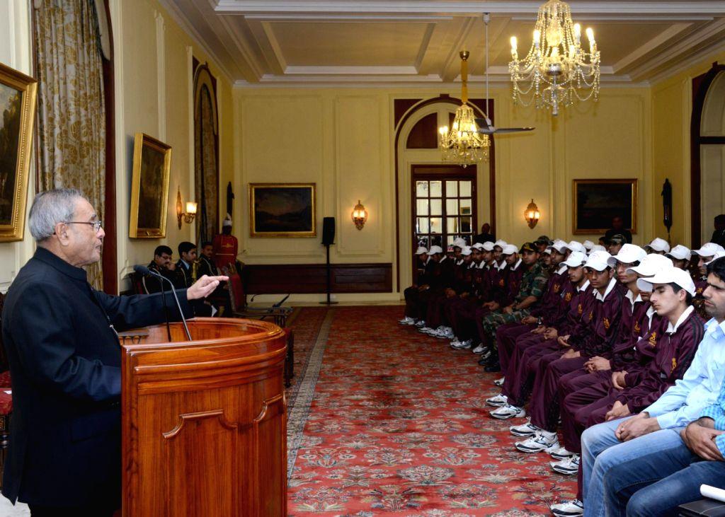 President Pranab Mukherjee addresses students from Ganderbal district of Jammu and Kashmir at Rashtrapati Bhavan in New Delhi on Dec.13, 2013