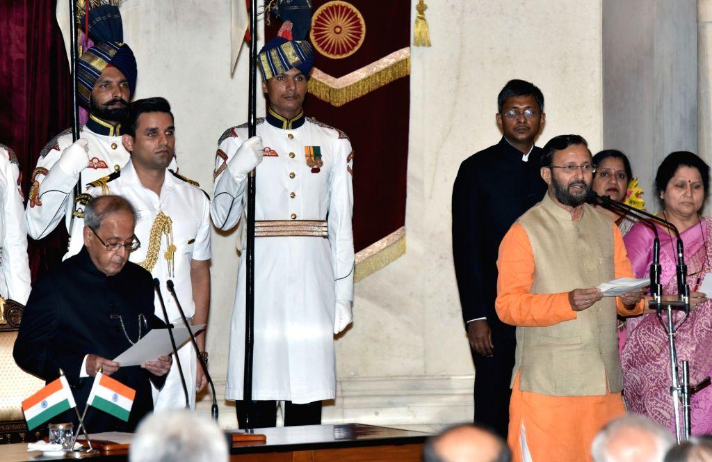 President Pranab Mukherjee administers the oath of Cabinet Minister to Prakash Javadekar, at a swearing-in ceremony organised at Rashtrapati Bhavan, in New Delhi on July 5, 2016. - Pranab Mukherjee