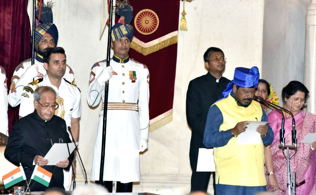 President Pranab Mukherjee administers the oath of Minister of State to Ramdas Athawale, at a swearing-in ceremony organised at Rashtrapati Bhavan, in New Delhi on July 5, 2016. - Pranab Mukherjee