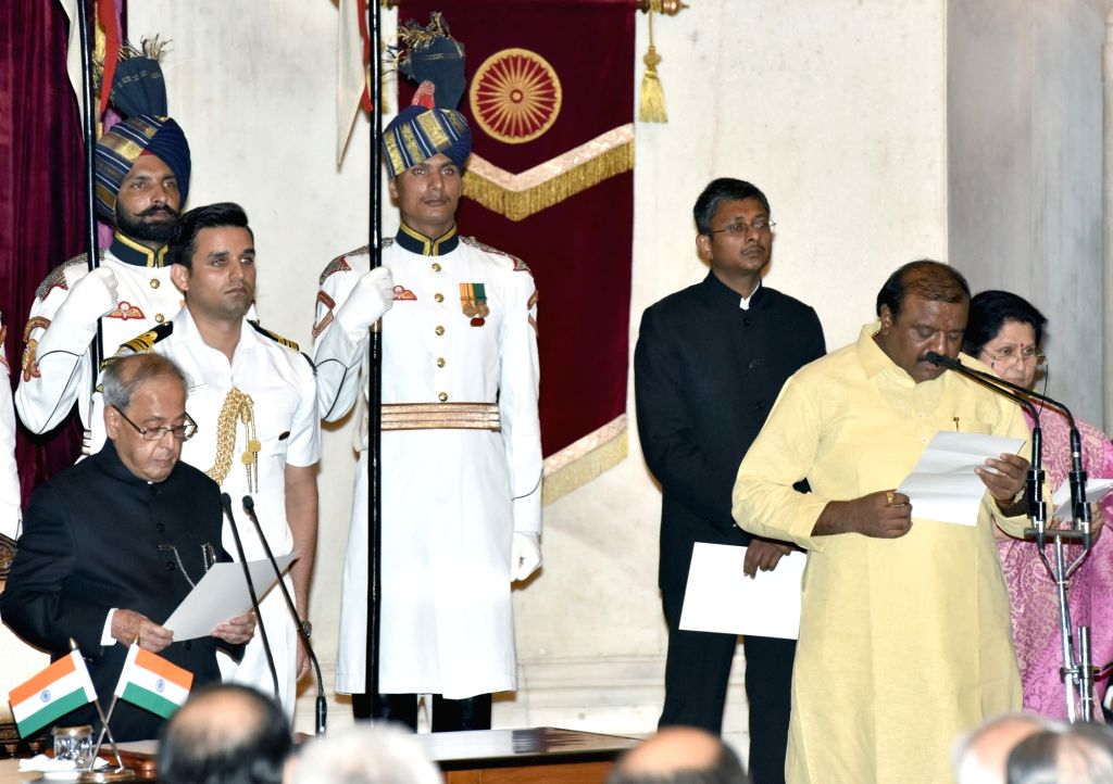 President Pranab Mukherjee administers the oath of Minister of State to Jaswantsinh Sumanbhai Bhabhor, at a swearing-in ceremony organised at Rashtrapati Bhavan, in New Delhi on July 5, ... - Pranab Mukherjee