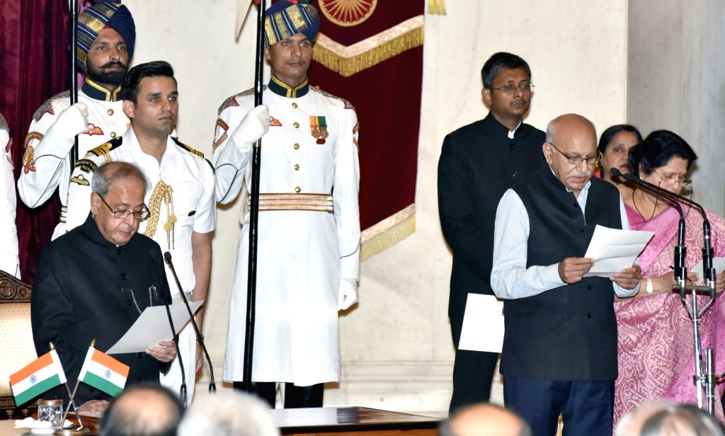 President Pranab Mukherjee administers the oath of Minister of State to M.J. Akbar, at a swearing-in ceremony organised at Rashtrapati Bhavan, in New Delhi on July 5, 2016. - Pranab Mukherjee