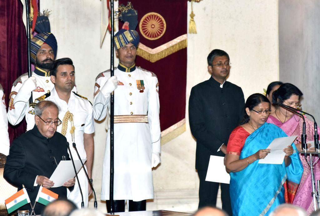 President Pranab Mukherjee administers the oath of Minister of State to Krishna Raj, at a swearing-in ceremony organised at Rashtrapati Bhavan, in New Delhi on July 5, 2016. - Pranab Mukherjee