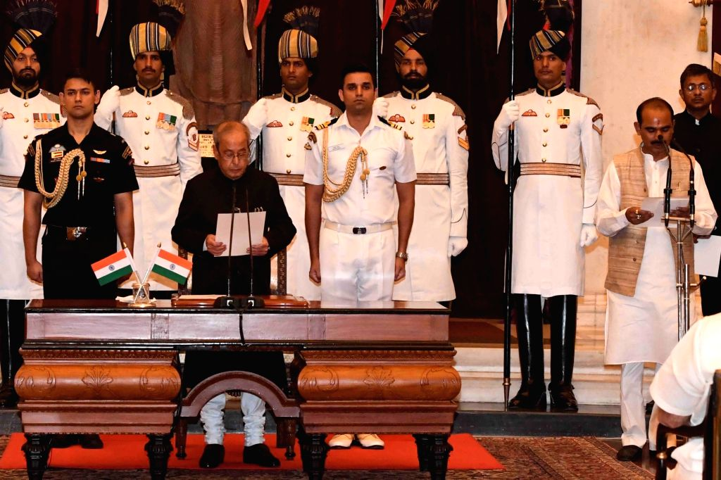 President Pranab Mukherjee administers the oath of Minister of State to Ajay Tamta, at a swearing-in ceremony organised at Rashtrapati Bhavan, in New Delhi on July 5, 2016. - Pranab Mukherjee