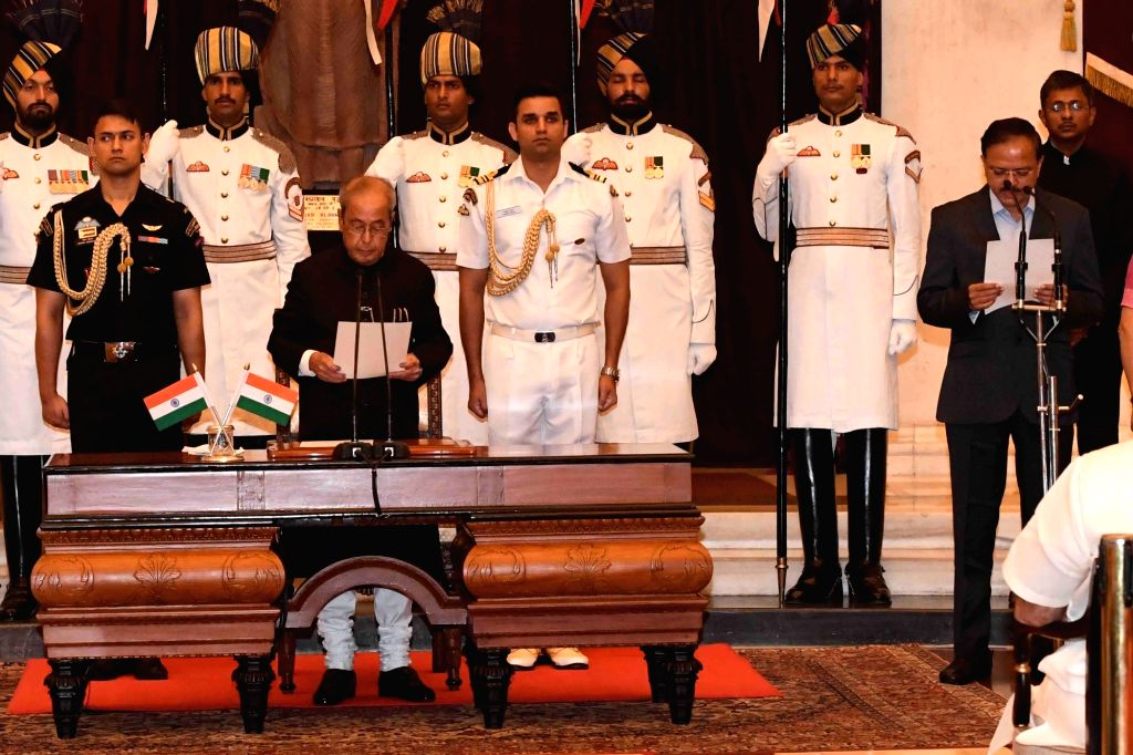 President Pranab Mukherjee administers the oath of Minister of State to Subhash Ramrao Bhamre, at a swearing-in ceremony organised at Rashtrapati Bhavan, in New Delhi on July 5, 2016. - Pranab Mukherjee