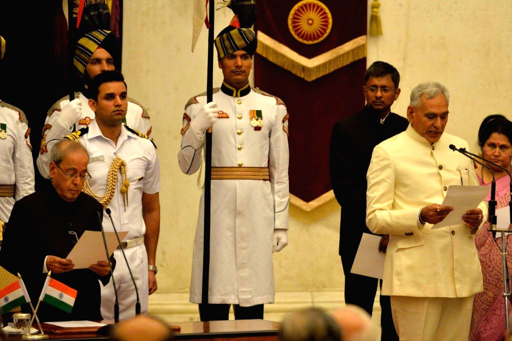 President Pranab Mukherjee administers the oath of Minister of State to C.R. Chaudhary, at a swearing-in ceremony organised at Rashtrapati Bhavan, in New Delhi on July 5, 2016. - Pranab Mukherjee and R. Chaudhary