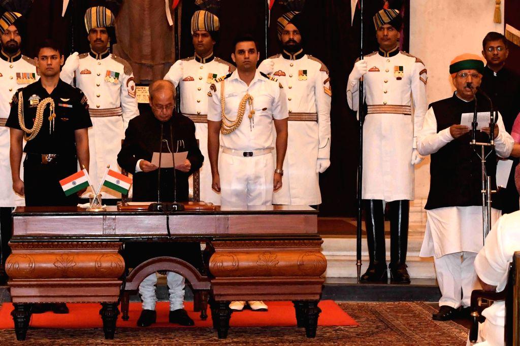 President Pranab Mukherjee administers the oath of Minister of State to Arjun Ram Meghwal, at a swearing-in ceremony organised at Rashtrapati Bhavan, in New Delhi on July 5, 2016. - Pranab Mukherjee