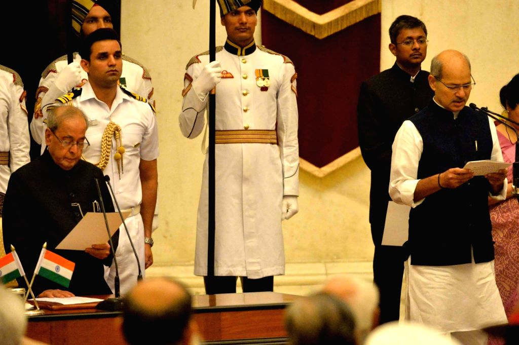 President Pranab Mukherjee administers the oath of Minister of State to Anil Madhav Dave, at a swearing-in ceremony organised at Rashtrapati Bhavan, in New Delhi on July 5, 2016. - Pranab Mukherjee