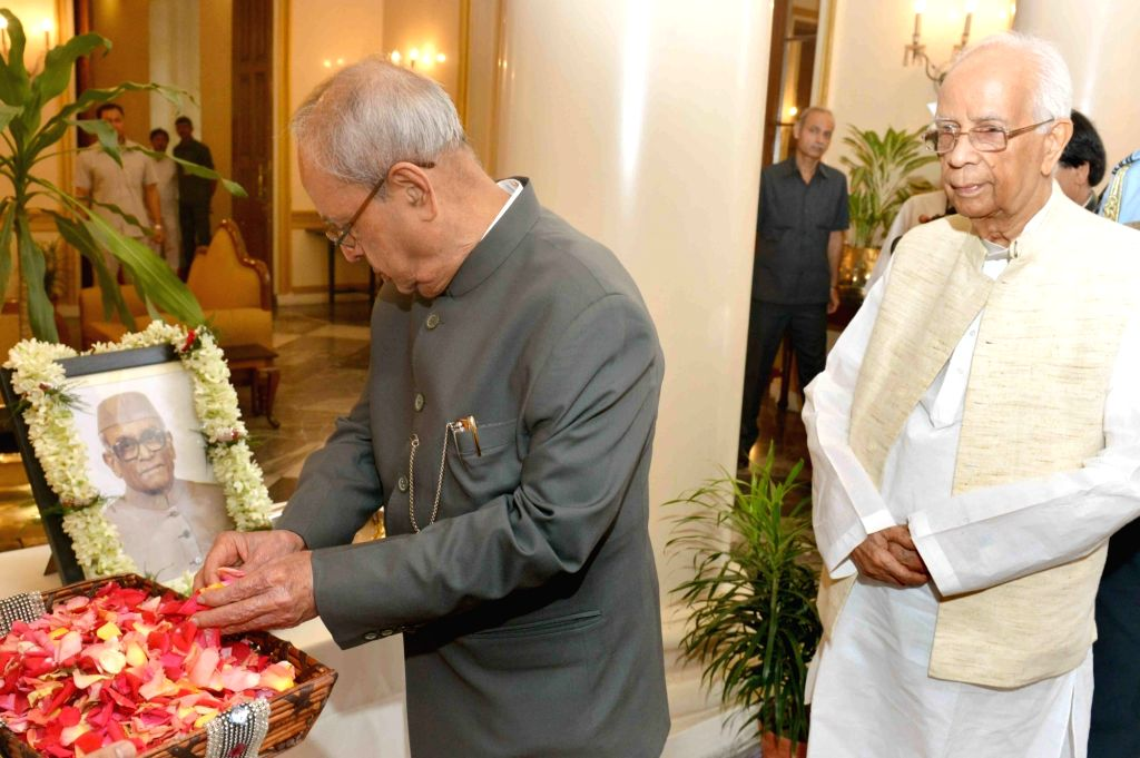 President Pranab Mukherjee along with West Bengal Governor Keshari Nath Tripathi pays floral tribute at the portrait of Former President of India Neelam Sanjiva Reddy, on his birth ... - Pranab Mukherjee, Keshari Nath Tripathi and Neelam Sanjiva Reddy