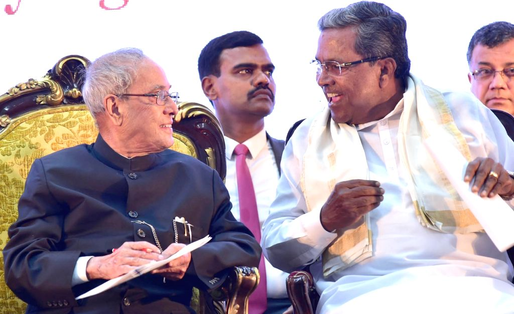 "President Pranab Mukherjee and Karnataka Chief Minister Siddaramaiah at the foundation laying stone of ""Bengaluru Dr. B. R Ambedkar School of Economics"" at Vidhana Soudha in ... - Siddaramaiah and Pranab Mukherjee"