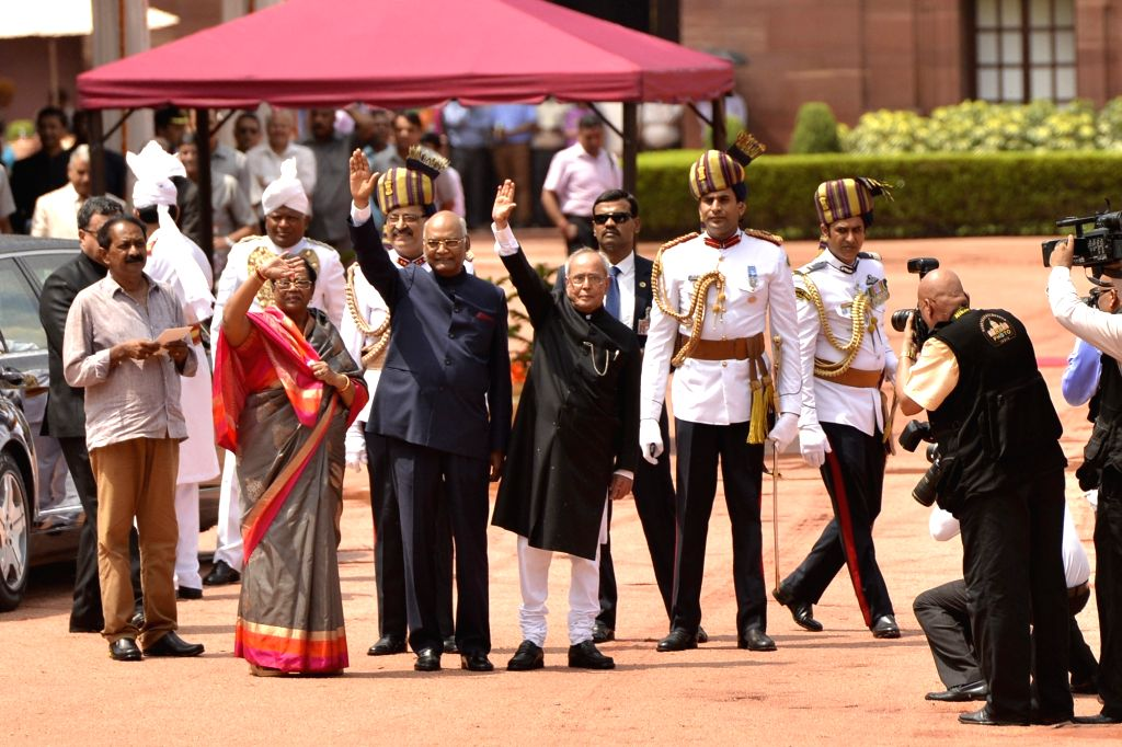 President Pranab Mukherjee and President- elect Ram Nath Kovind during their departure from Rashtrapati Bhavan to Parliament for the swearing-in- ceremony, in New Delhi on July 25, 2017. - Pranab Mukherjee and Nath Kovind