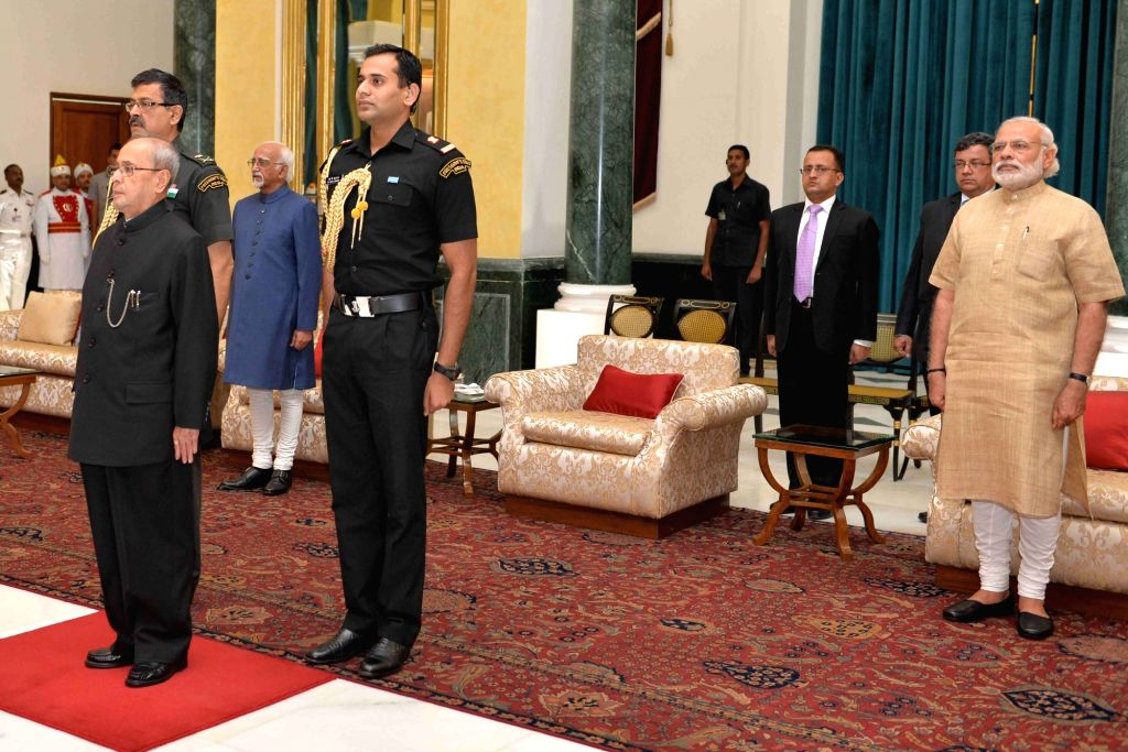 President Pranab Mukherjee and Prime Minister Narendra Modi during a reception organised on the occasion of Civil Services Day in New Delhi on April 20, 2016. - Narendra Modi and Pranab Mukherjee