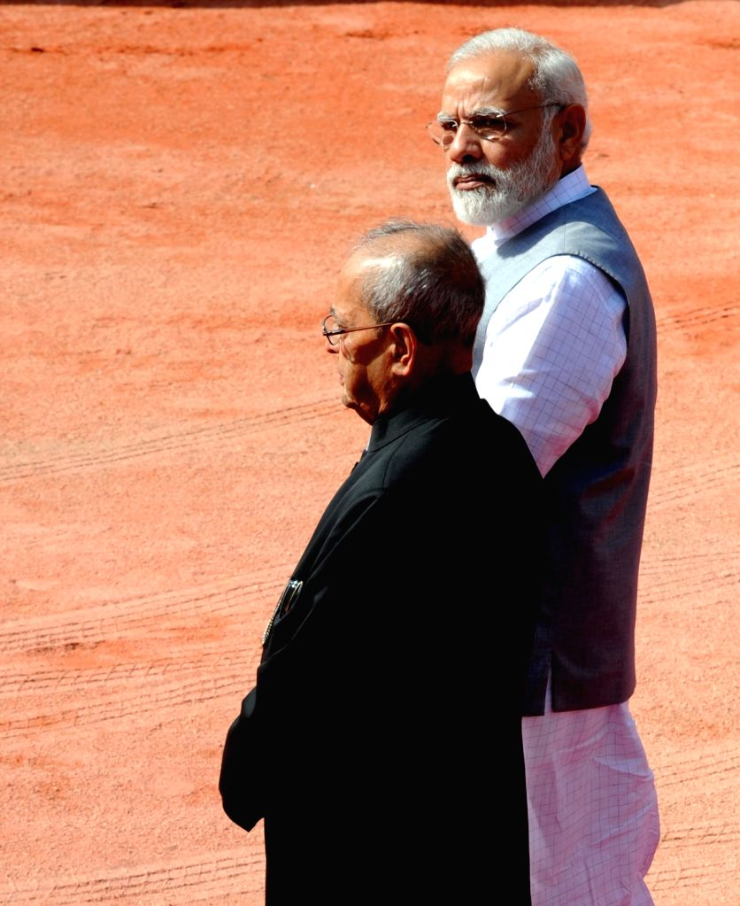 President Pranab Mukherjee and Prime Minister Narendra Modi wait for Turkish President Recep Tayyip Erdogan to arrive at a Ceremonial Reception organised for him at Rashtrapati Bhavan, in ... - Narendra Modi and Pranab Mukherjee