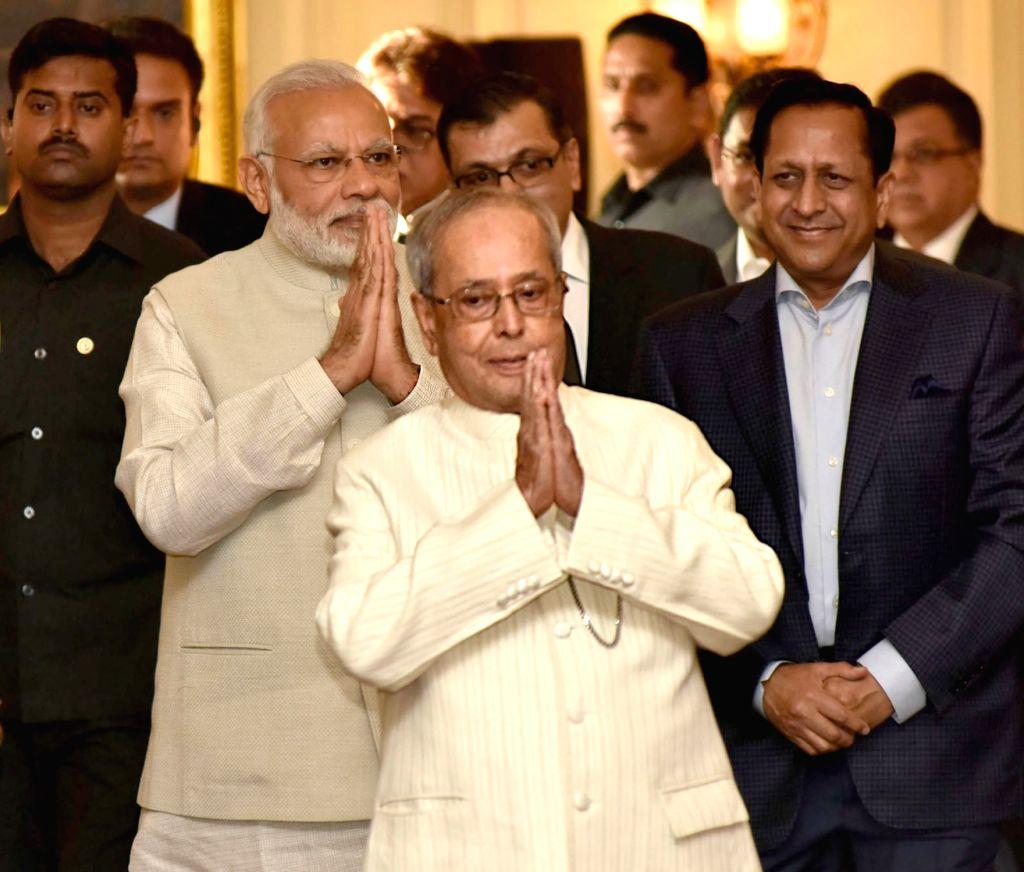 "President Pranab Mukherjee and Prime Minister Narendra Modi during a programme organised to release a book titled ""President Pranab Mukherjee - A Statesman"" at Rashtrapati Bhawan ... - Narendra Modi and Pranab Mukherjee"