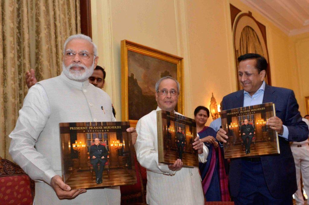 "President Pranab Mukherjee and Prime Minister Narendra Modi during a programme organised to release a book titled ""President Pranab Mukherjee - A Statesman""  at Rashtrapati ... - Narendra Modi and Pranab Mukherjee"